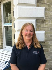 Sue Hudson, Massage Therapist, standing outside of Lushington Chiropractic