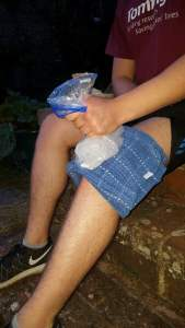 Image shows a man's knee with towel acting as barrier, ice in bag is on top of the knee to accompany the blog by Lizzie Wright on sciatica