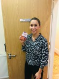 Image shows Eastbourne Chiropractor Gemma Crouch at Lushington Chiropractic holding a carton of Lambert's Tumeric Food Supplements to accompany her blog on the benefits of Tumeric