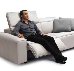 man relaxing on reclining sofa-best sofa for back support
