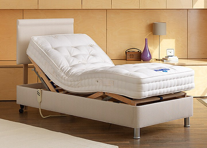 adjustable bed with white mattress