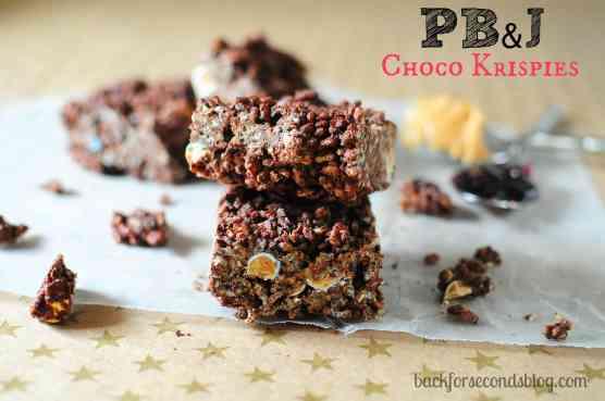 Peanut Butter and Jelly Chocolate Rice Krispie Treats https://backforseconds.com #recipe #nobake #chocolate #peanutbutterandjelly
