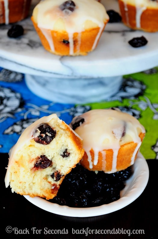 Lemon Muffins with Sour Cherries and a Sweet Vanilla Glaze! Light, fluffy, and full of bright flavors! https://backforseconds.com #breakfast #muffins #recipe #lemon