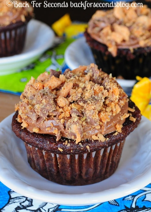 Chocolate Butterfinger Cupcakes - I declare these the best cupcakes on the planet! Everyone loves them! https://backforseconds.com #butterfinger #cupcakes #candy #chocolate