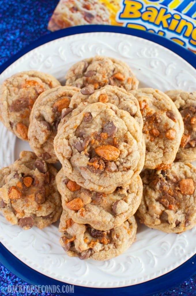 These Brown Butter Butterfinger Cookies are every bit as good as they sound! Chewy, buttery cookies with chocolate, peanut butter chips, and butterfingers!