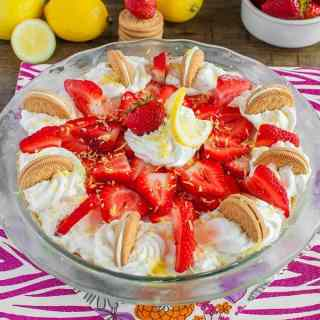 No Bake Strawberry Lemon Cheesecake Pie is the ultimate summer dessert! Light, creamy lemon cheesecake is loaded with strawberries atop a golden Oreo crust!