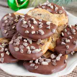 Chocolate Dipped Mint Chocolate Chip Cookies on a white plate
