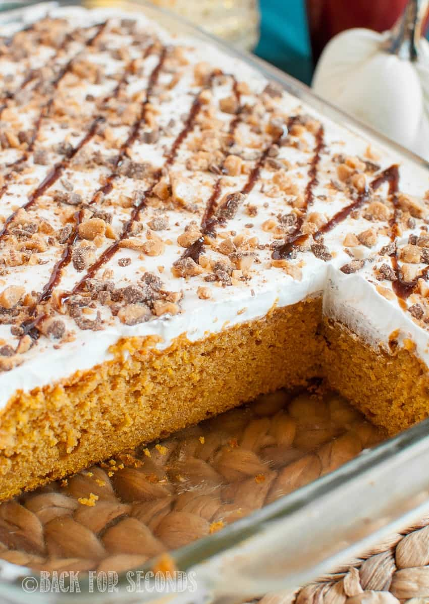 Pumpkin Butterscotch Poke Cake drizzled with chocolate and toffee in a pan