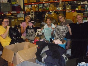 Helping organize the thrift shop for the members of Haven for Hope.