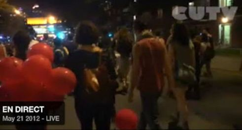 Image: Quebec protestors carrying red balloons