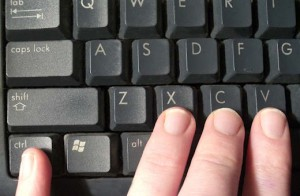 Fingers copy and pasting on keyboard