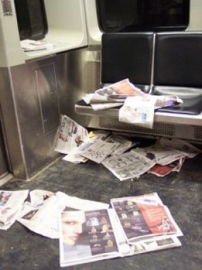 Newspapers on subway floor