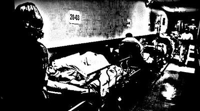 Patients on stretchers in hospital corridor