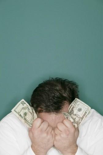 Distressed guy holding money