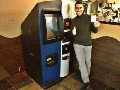 Happy man at bitcoin machine