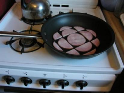 CBC logo as frying bacon