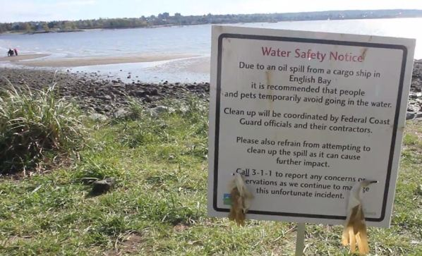 Oil warning sign at English Bay