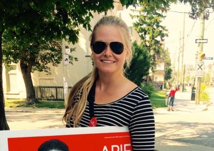 Katrina carrying election sign