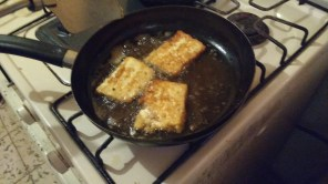Cheese frying in 'a little oil'.