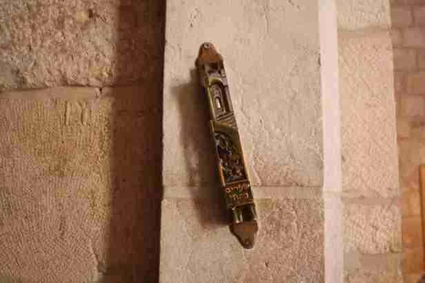 Mezuzah on the side of the doorway