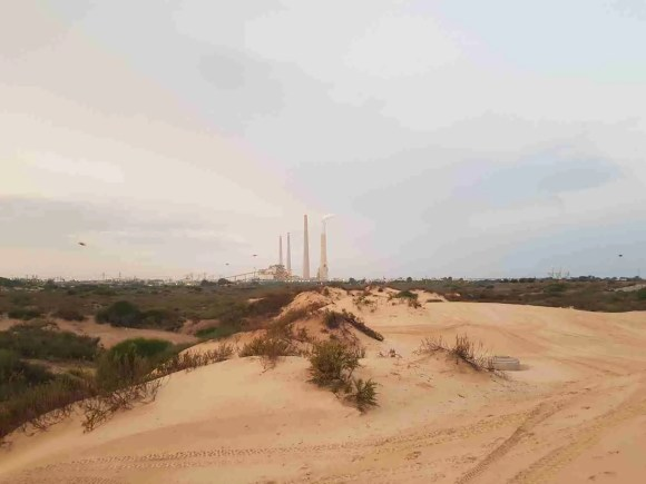 The chimneys of Orot Rabin in the distance on the Israel National Trail