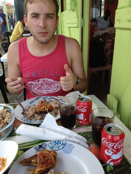 Justin chowing down on amazing creole fish and rice in St. Rose, Guadeloupe