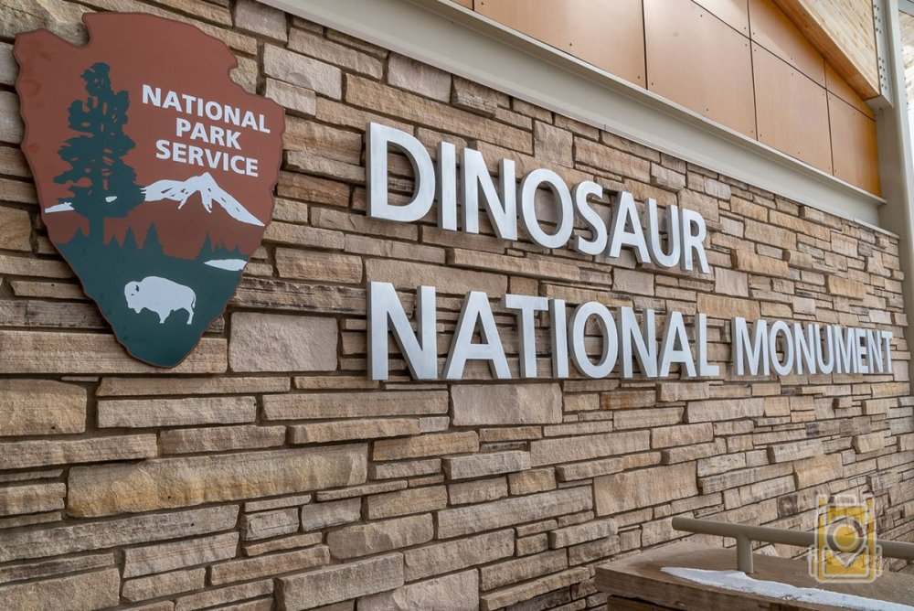 The sign to Dinosaur National Monument at the Quarry Building, where you can see exposed dinosaur fossils in a rock wall