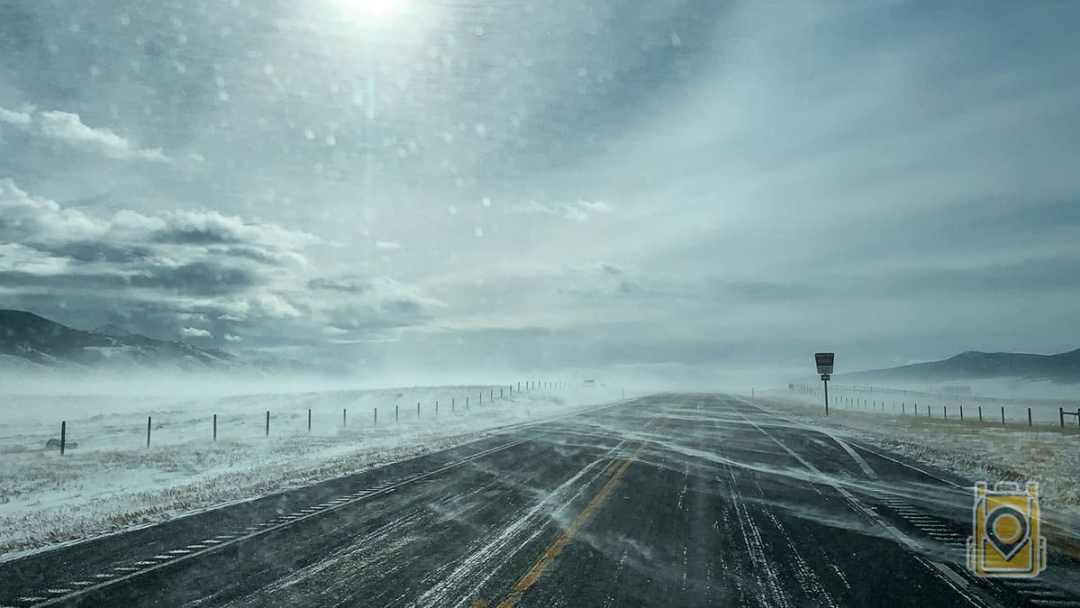 USA Road Trip Planner: Snow blowing across a Montana highway.