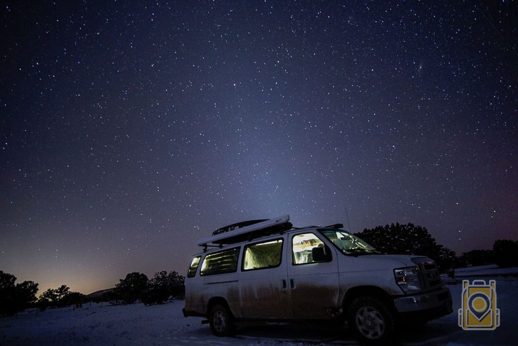 Our van at night with a starry sky overhead
