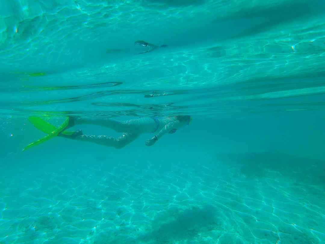 How to spend two days in Key Largo: Book a snorkeling trip. Tiffany glides through the tropical waters on a snorkeling getaway.