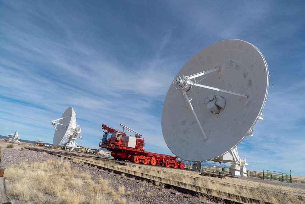 Visiting the Very Large Array: the giant, 25-meter radio telescope antennas move across the grounds on railroad tracks.