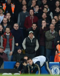 Terry, as a substitute, taunts West Ham's fans on 17 March, 2013.