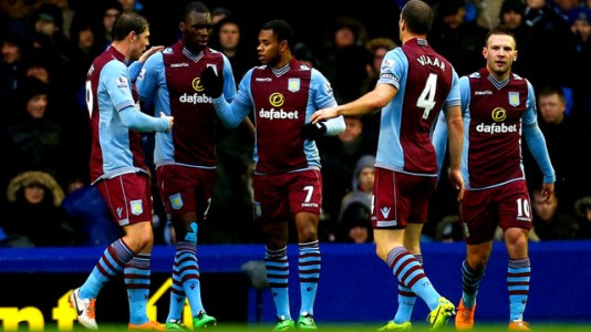 Leandro Bacuna (C) of Aston Villa celebrates after scoring a goal with team mates during the Barcla