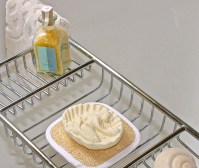 Bathtub Shelf With Bath Salts And Pretty Milled Soaps