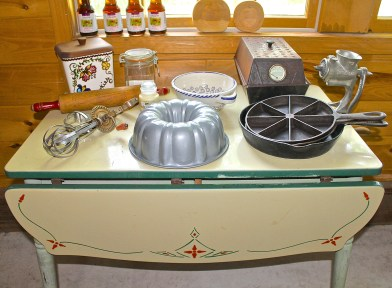 Antique Kitchen Table With Kitchenware Both Old And New