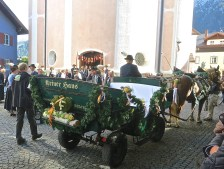 A Flower Decorated Carriage Awaits The Bride And Groom