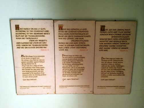 Scripture and memorial inside the hiding place in Corrie ten Boom's bedroom.