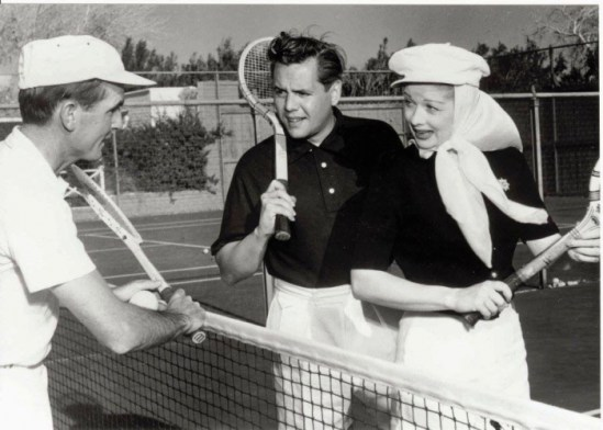 Desi Arnaz and Lucille Ball with tennis rackets
