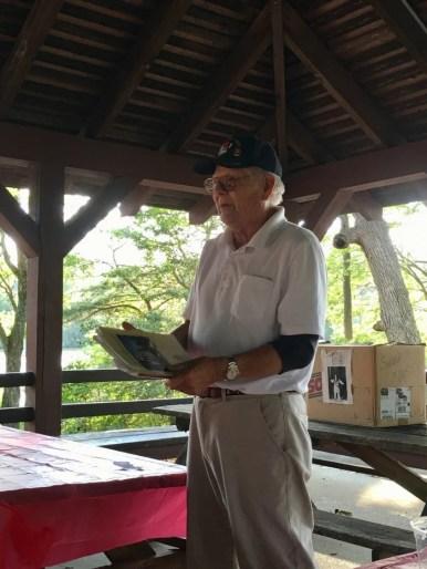 man speaking at picnic pavilion