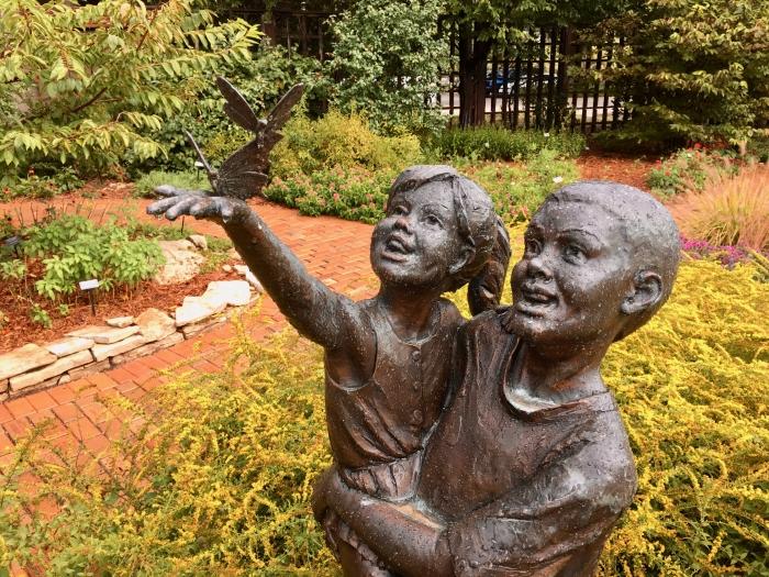 statue of children in a garden