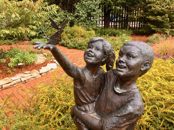 statue of children in a garden