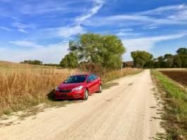 car parked along dirt road