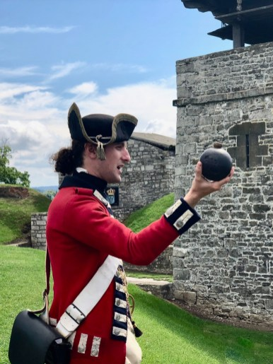 British redcoat holding a cannonball