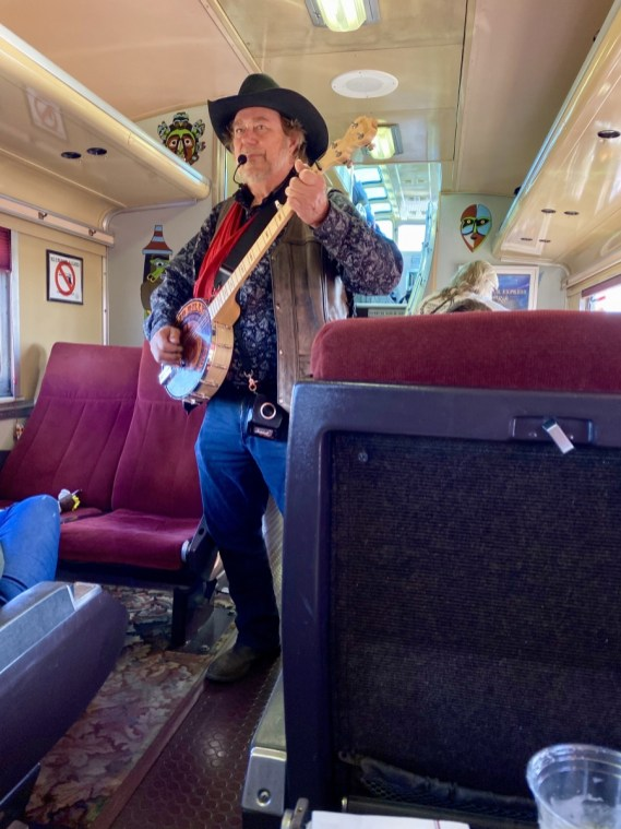 Grand Canyon Railway entertainer - Take the Train to Grand Canyon National Park: An Insider's Guide