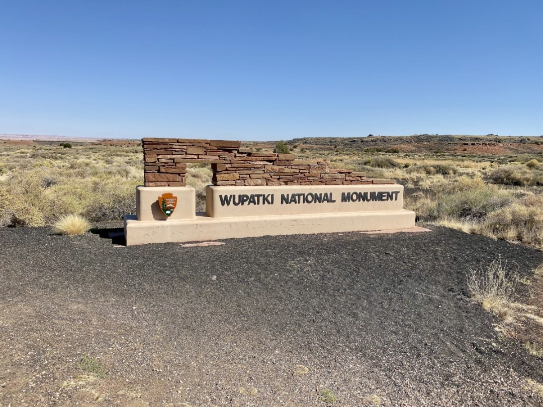 Wupatki National Monument sign - 3 Magnificent Flagstaff National Monuments