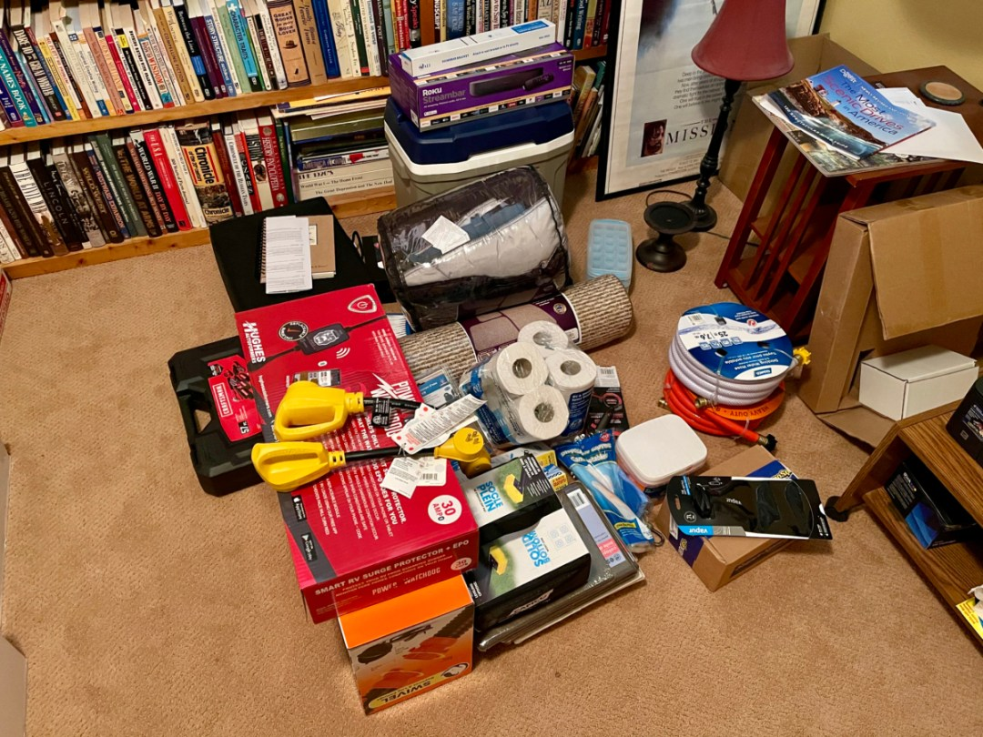 Pile of RV Accessories - A Guide for Buying a Camper Van: My Story & Lessons Learned