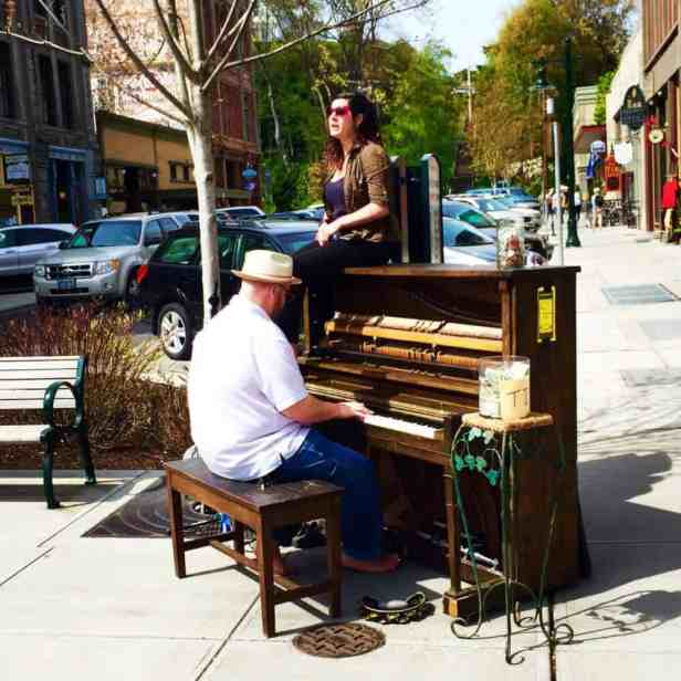 A man playing a piano in downtown Port Townsend, Washington