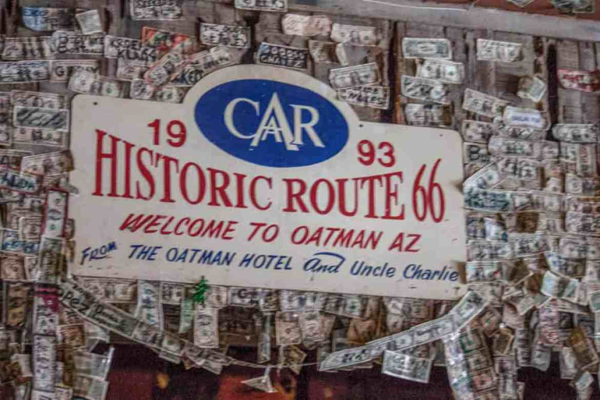 A close up of the dollar bills lining the wall in the Oatman Hotel