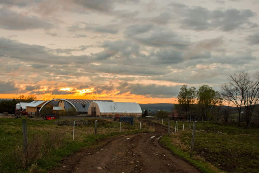 A vibrant sunset over the fields of Stony Pond Farm in Vermont.