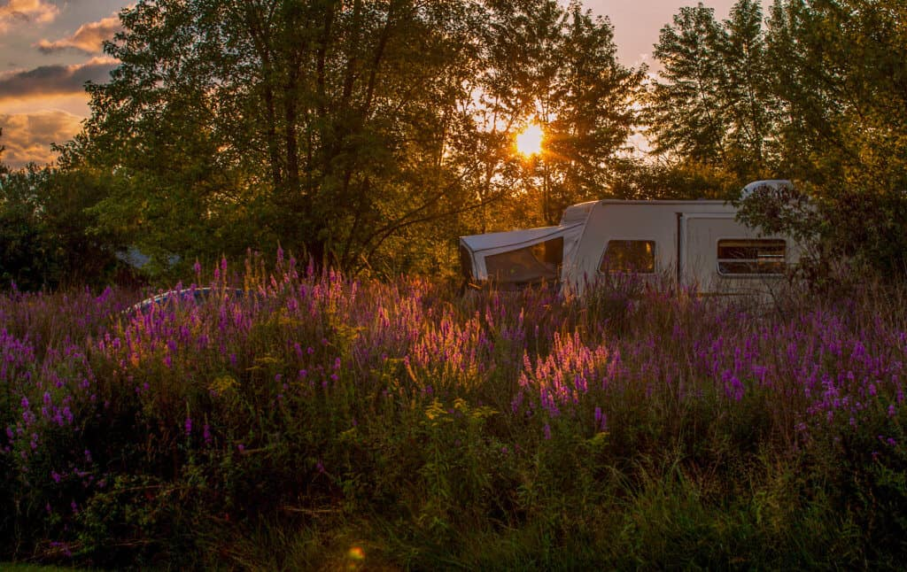 Sunset behind a pop-up camper at Button Bay State Park in Vermont